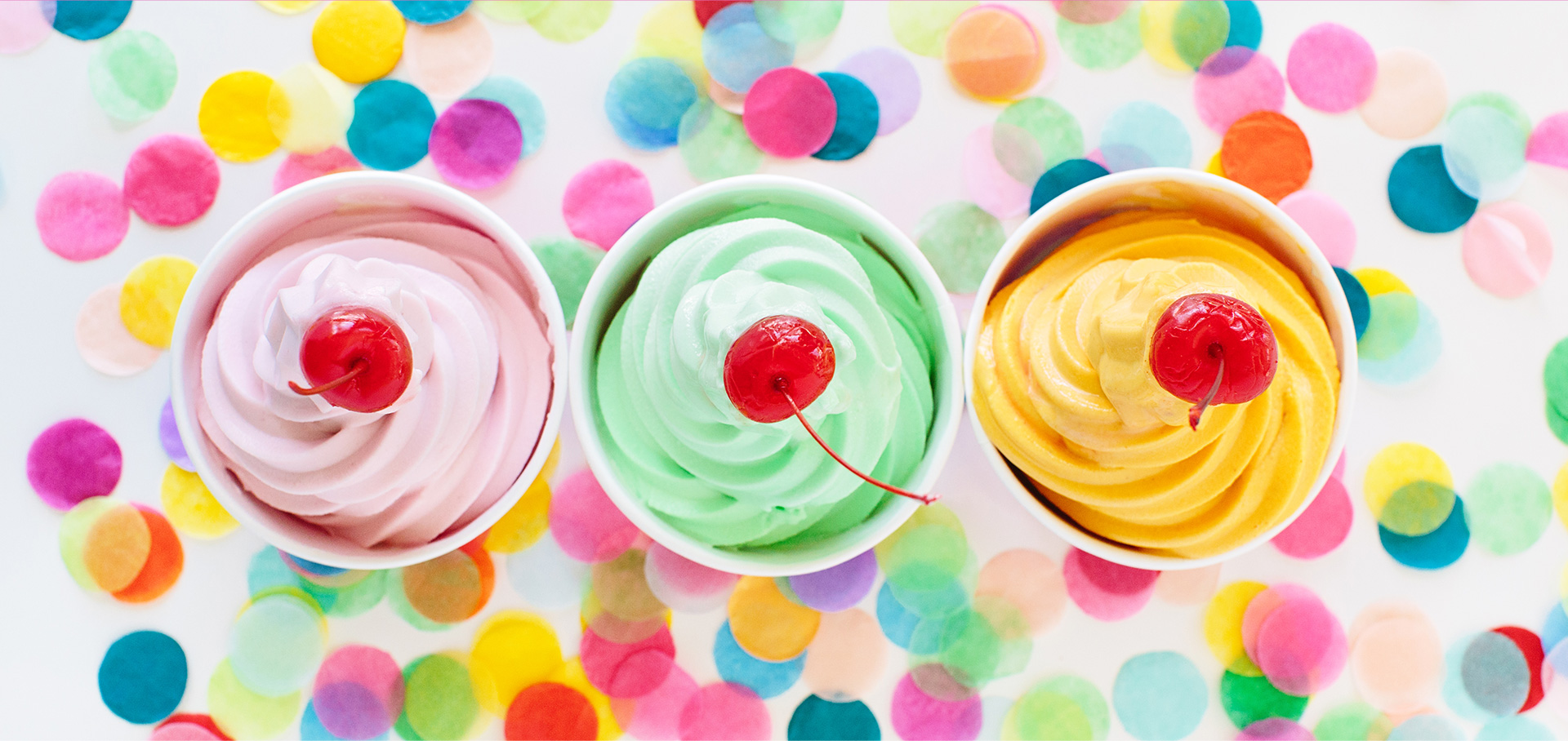 Three colorful cups of Menchie's frozen yogurt