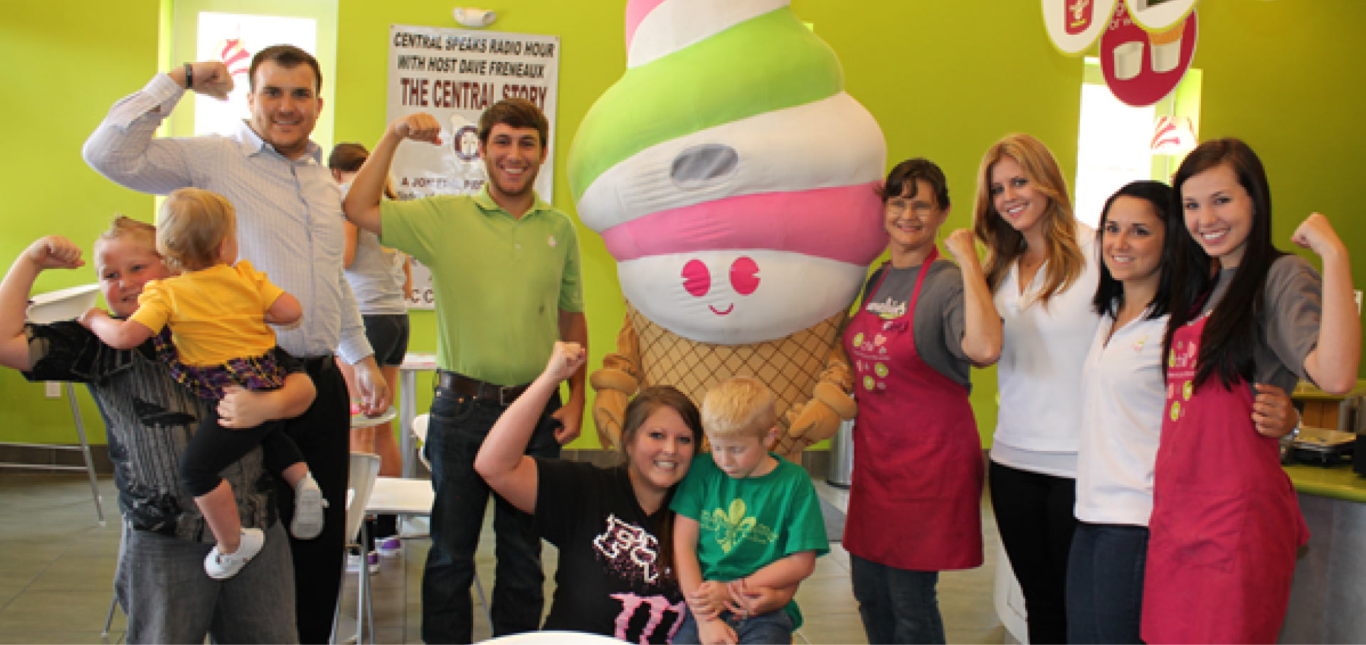 Menchie's team members posing with customers inside a store