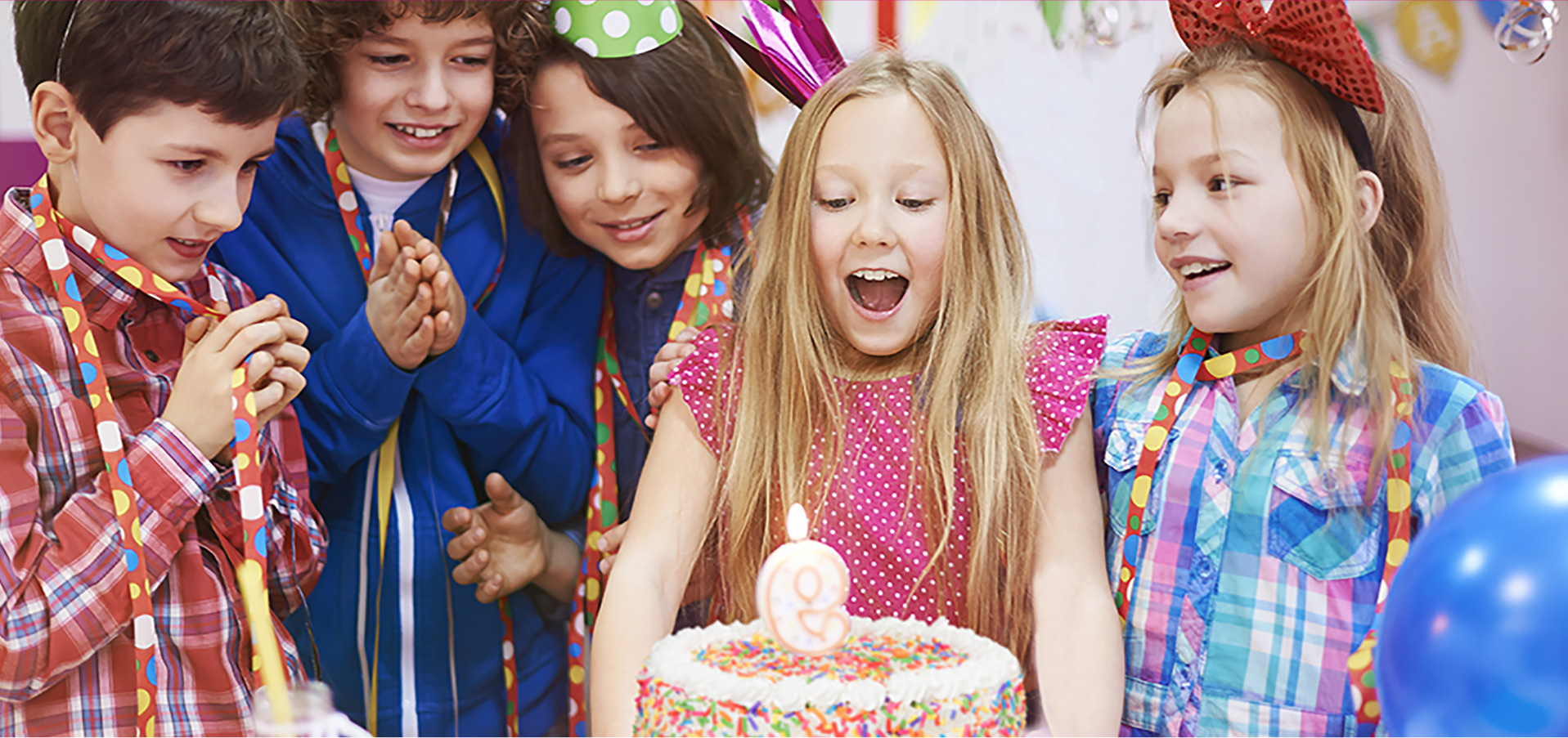 Five children standing around a Menchie's frozen yogurt birthday cake